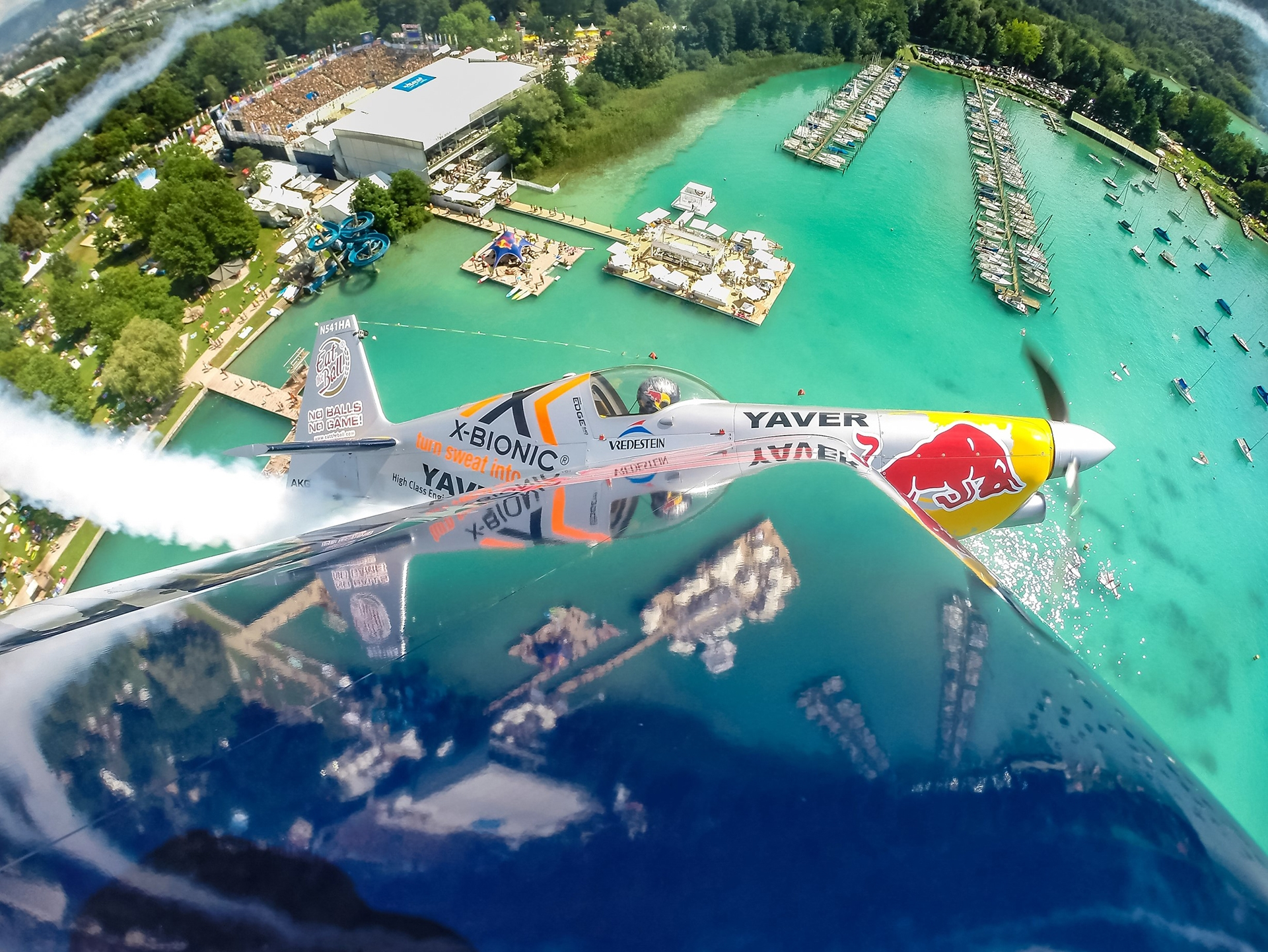 Red Bull Air Racer above the Wörthersee and the Center Court in Klagenfurt credit: ACTS Group