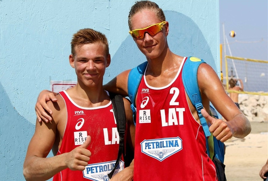 Aleksandrs' younger brother, Mihails (right) and partner Kristaps Smits. Photocredit: FIVB