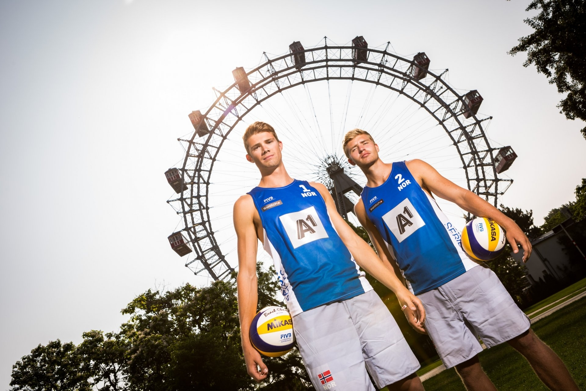 Anders (left) and Christian back on the ground after their game of beach volleyball 215 feet high
